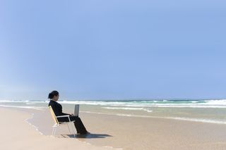 Bigstockphoto_Businesswoman_At_Beach_180939