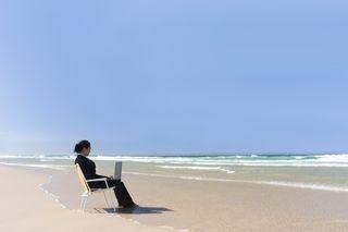 Bigstockphoto_Businesswoman_At_Beach_180939